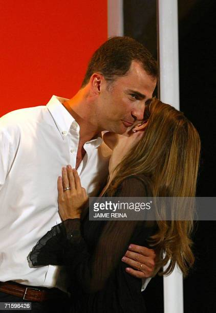 Spain's Prince Felipe kisses his wife Letizia during a delivery of trophies of the 25th Copa del Rey regatta sailing at Bellver's Castle in Palma de...