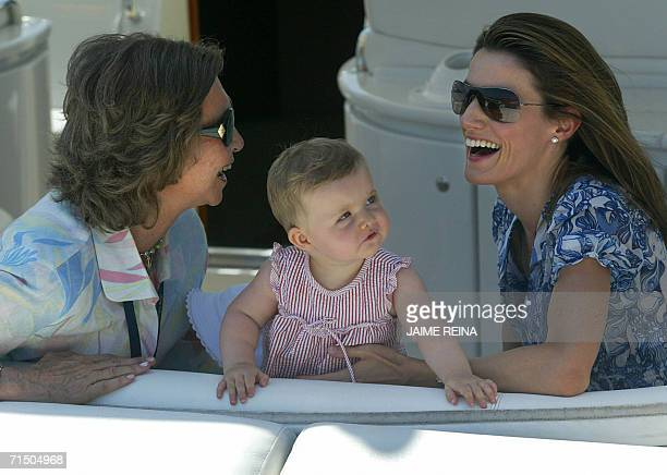 Spain's Queen Sofia granddaughter Leonor and mother Princess Letizia pose at Puerto Portals on Mallorca 23 July 2006 The Royal Family is in Palma de...