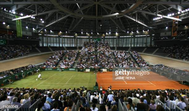 Spain's Rafael Nadal and Swiss Roger Federer play during the exhibition game the battle of the surfaces in a special court of half clay and half...