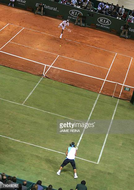 Spain's Rafael Nadal and Switzerland's Roger Federer play an exhbition game in Palma de Mallorca on a court with two surfaces clay and grass 02 May...