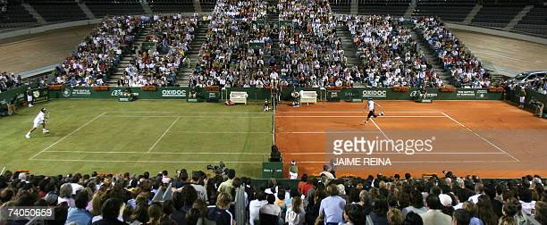Spain's Rafael Nadal returns to Swiss Roger Federer during an exhbition game in Palma de Mallorca on a court with two surfaces clay and grass 02 May...