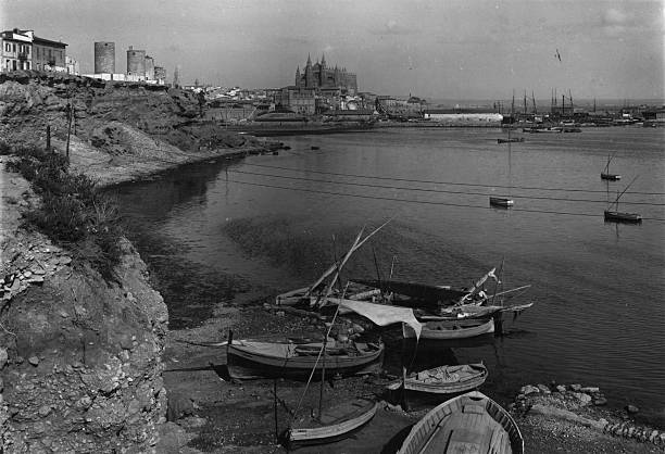 A view of Palma harbour in Majorca, with the old windmills...