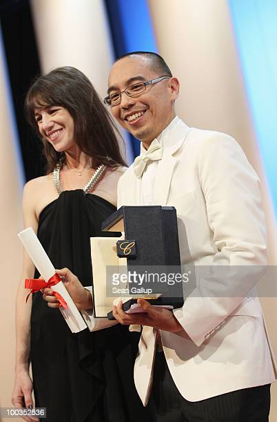 Palme d'Or winner for ''Uncle Boonmee Who Can Recall His Past Lives' director Apichatpong Weerasethakul poses with actress Charlotte Gainsbourg...