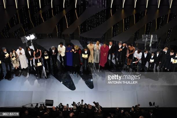 Palme d'Or winner Japanese director Hirokazu KoreEda poses with jury members and laureates Polish director Pawel Pawlikowski Best Actress laureate...