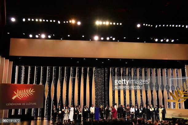 TOPSHOT Palme d'Or winner Japanese director Hirokazu KoreEda poses with jury members and laureates Best Director Laureate Polish director Pawel...