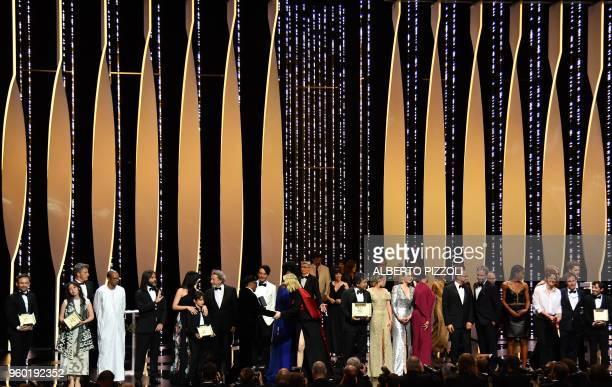 Palme d'Or winner Japanese director Hirokazu KoreEda poses with jury members and laureates Best Short Film Camera d'Or laureate Australian director...