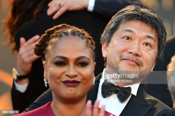 Palme d'Or winner Japanese director Hirokazu KoreEda waves a he attends on May 19 2018 a performance on the red carpet during the closing ceremony of...