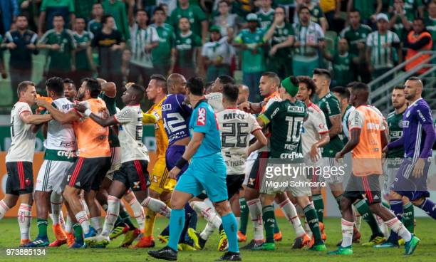 Palmeiras and Flamengo team players fight during a match for the Brasileirao Series A 2018 at Allianz Parque Stadium on June 13 2018 in Sao Paulo...