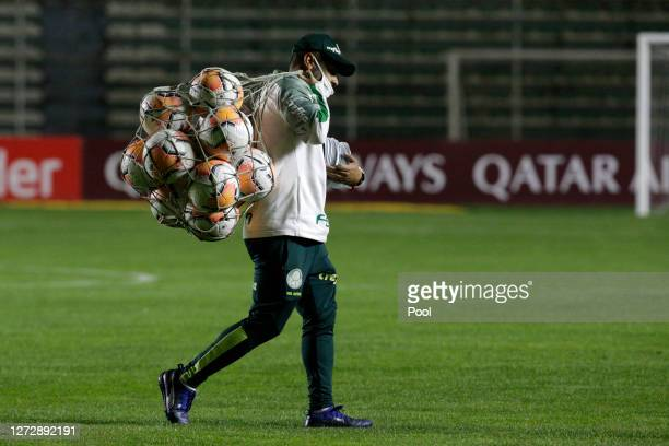 Palmeiras coach assitant carries official match balls before a group B match of Copa CONMEBOL Libertadores 2020 between Bolivar and Palmeiras at...