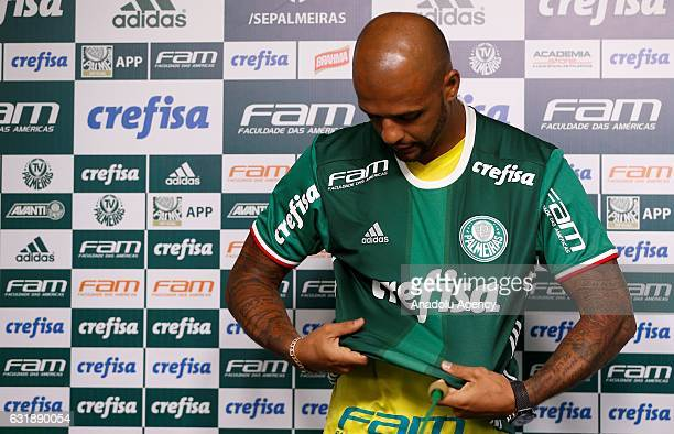 Palmeiras's new Brazilian player Felipe Melo wears his jersey during his official presentation in Sao Paulo Brazil on January 17 2017