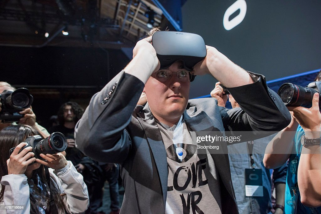 Palmer Luckey, co-founder and creator of the Oculus Rift of Oculus VR. Inc., demonstrates the new Oculus Rift headset during the 'Step Into The Rift' event in San Francisco, California, U.S., on Thursday, June 11, 2015. Facebook Inc.'s Oculus virtual-reality headsets will work with Microsoft Corp.'s Windows 10 and use the software maker's wireless Xbox game controller. Photographer: David Paul Morris/Bloomberg via Getty Images
