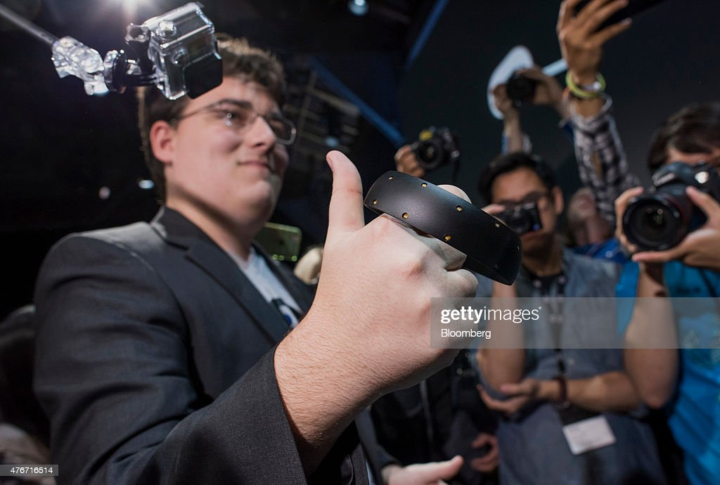 Palmer Luckey, co-founder of Oculus VR Inc. and creator of the Oculus Rift, demonstrates the new Oculus Touch controller during the 'Step Into The Rift' event in San Francisco, California, U.S., on Thursday, June 11, 2015. Facebook Inc.'s Oculus virtual-reality headsets will work with Microsoft Corp.'s Windows 10 and use the software maker's wireless Xbox game controller. Photographer: David Paul Morris/Bloomberg via Getty Images