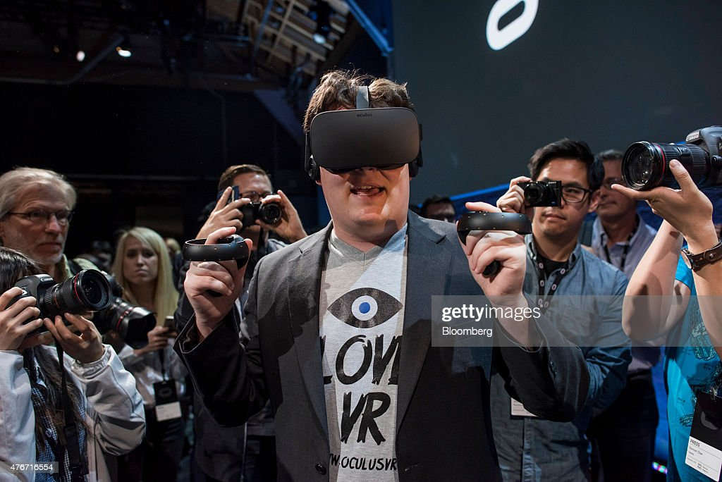 Palmer Luckey, co-founder of Oculus VR Inc. and creator of the Oculus Rift, demonstrates the new Oculus Rift headset and Touch controller during the 'Step Into The Rift' event in San Francisco, California, U.S., on Thursday, June 11, 2015. Facebook Inc.'s Oculus virtual-reality headsets will work with Microsoft Corp.'s Windows 10 and use the software maker's wireless Xbox game controller. Photographer: David Paul Morris/Bloomberg via Getty Images