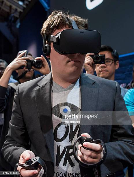 Palmer Luckey cofounder of Oculus VR Inc and creator of the Oculus Rift demonstrates the new Oculus Rift headset during the 'Step Into The Rift'...