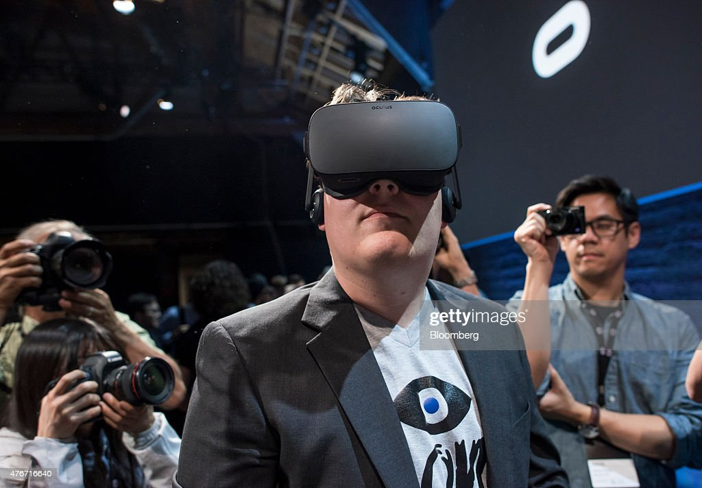 Palmer Luckey, co-founder of Oculus VR Inc. and creator of the Oculus Rift, demonstrates the new Oculus Rift headset during the 'Step Into The Rift' event in San Francisco, California, U.S., on Thursday, June 11, 2015. Facebook Inc.'s Oculus virtual-reality headsets will work with Microsoft Corp.'s Windows 10 and use the software maker's wireless Xbox game controller. Photographer: David Paul Morris/Bloomberg via Getty Images