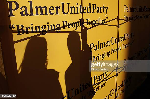 Palmer United staff secure a sign during a press conference at Parliament House on May 4 2016 in Canberra Australia The Turnbull Goverment's first...