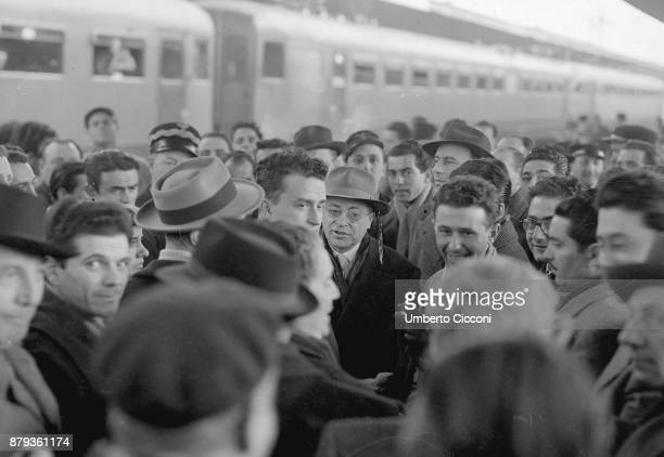 Palmiro Togliatti in the crowd at the train station 1948