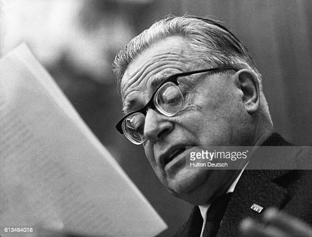 Palmiro Togliatti the leader of the Italian communist party reading He made the introductory speech at the party's 10th annual congress where many of...