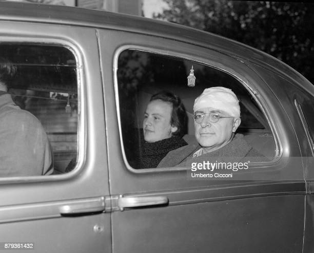 Palmiro Togliatti with a bandage on his head after he survived an assassination attempt in 1948. He is with Nilde Iotti.