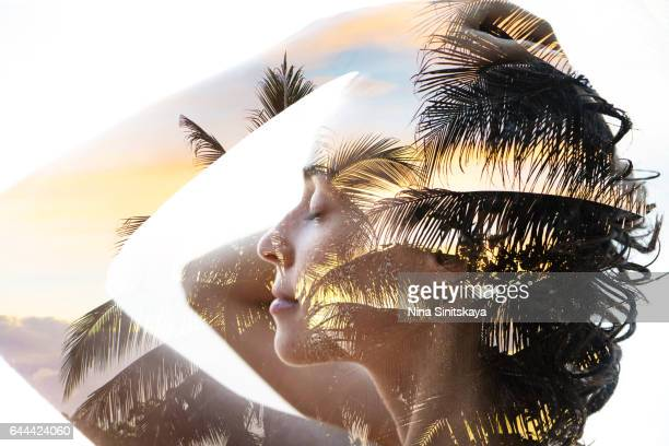 Palms on sunset and woman's body - double exposure image