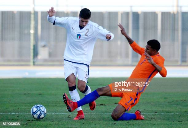 Palo Ghiglione of Italy U20 competes with Juninho Bacuna of Netherlands U20 during the 8 Nations Tournament match between Italy U20 and Netherlands...