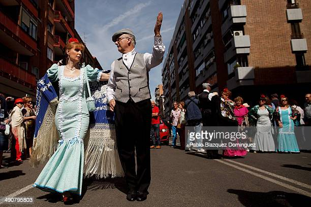 Paloma Clemente and Agustin Torres dance a 'chotis' during the San Isidro festivities near Pradera de San Isidro park on May 15 2014 in Madrid Spain...
