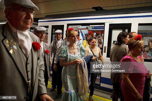 Paloma Clemente and other 'chulapos' walk out from a train during the San Isidro festivities on their way to Pradera de San Isidro park on May 15...