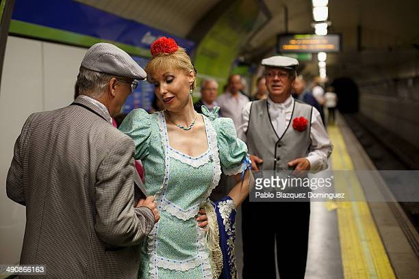 Paloma Clemente dance a 'chotis' with her husband Agustin Torres during the San Isidro festivities as they wait for the train on their way to Pradera...