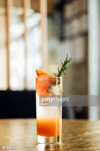 paloma cocktail on a bar counter - garnish stock pictures, royalty-free photos & images