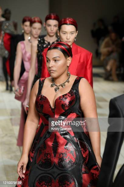 Paloma Elsesser walks the runway with models during the Alexander McQueen as part of Paris Fashion Week Womenswear Fall/Winter 2020/2021 on March 02...