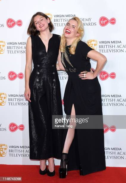 Paloma Faith and Emma Corin pose in the Press Room at the Virgin TV BAFTA Television Award at The Royal Festival Hall on May 12 2019 in London England