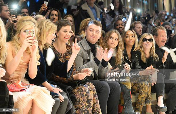 Paloma Faith, Clemence Posey, Maggie Gyllenhaal, Sam Smith, Cara Delevingne, Jourdan Dunn, Kate Moss and Mario Testino attend the Burberry Prorsum AW...