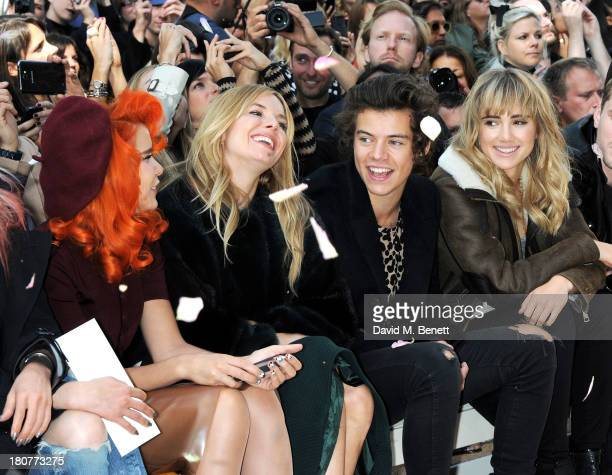 Paloma Faith Sienna Miller Harry Styles and Suki Waterhouse attends the front row at Burberry Prorsum Womenswear Spring/Summer 2014 show during...