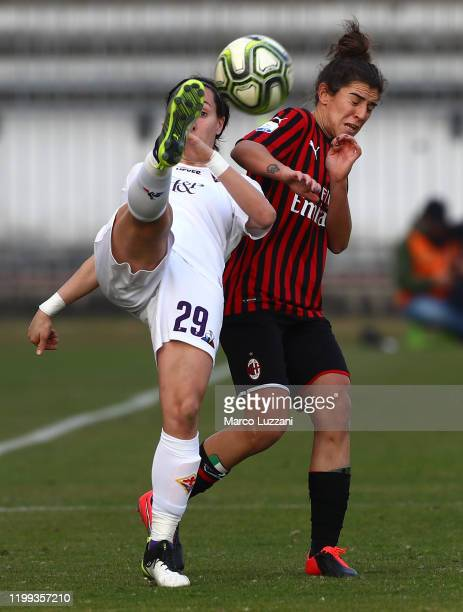 Paloma Lazaro of ACF Fiorentina is challenged by Valentina Bergamaschi of AC Milan during the Women Coppa Italia match between AC Milan and ACF...