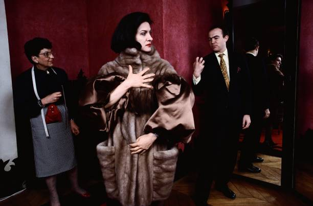 Paloma Picasso Trying on Fur Coat