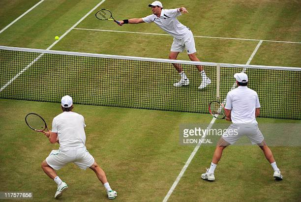 US palyers Bob Bryan and Mike Bryan play against Swedish player Simon Aspelin and Australian player Paul Hanley during Gentlemen's Doubles third...