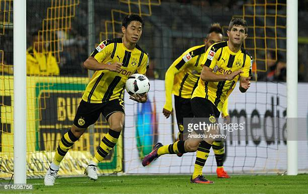 Palyers of Borussia Dortmund celebrate after scoring a goal during the Bundesliga soccer match between Borussia Dortmund and Hertha BSC Berlin at the...