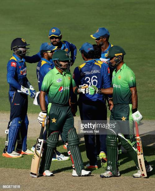 Palyers of Sri Lanka wait for a pending decision during the first One Day International match between Pakistan and Sri Lanka at Dubai International...