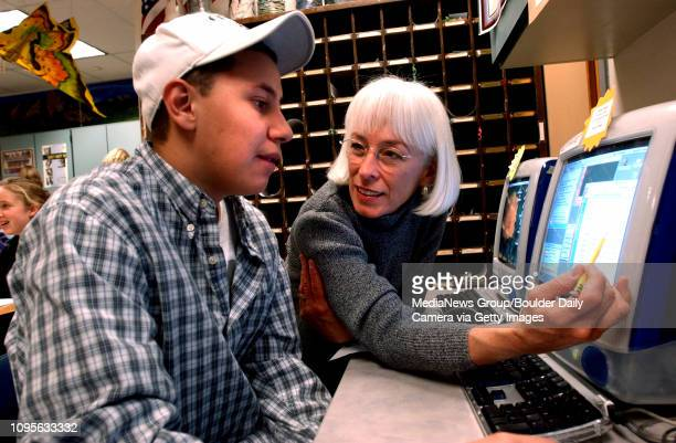 Pam Allen at right Director of the Boulder High School Tutoring Program helps senior Edgar Portillo work through an algebra problem They were working...