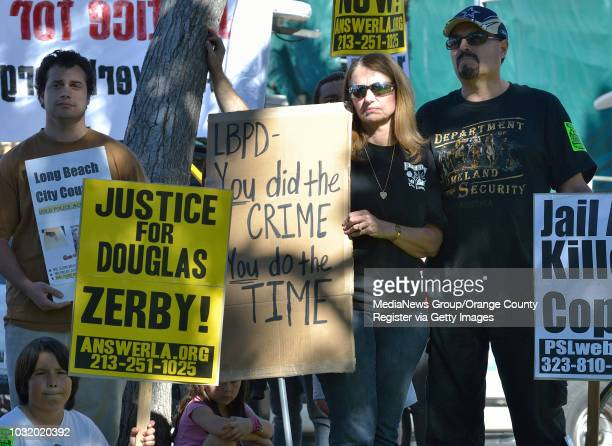 BEACH CALIF USA Pam Amici and her fiancee Richard Armijo during a protest against the unarmed shooting of her son Douglas Zerby at Bixby Park in Long...