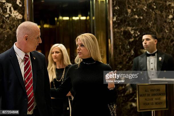 Pam Bondi Attorney General of Florida prepares to exit Trump Tower December 2 2016 in New York City Presidentelect Donald Trump and his transition...