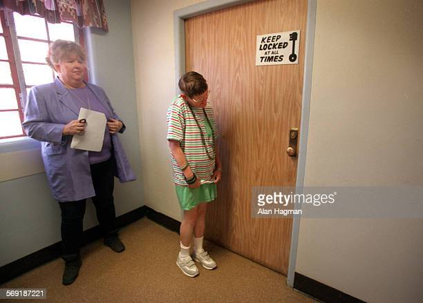 Pam Chase a patient on Unit 88 at Camarillo State Hospital for 28 years waits for her group to be lead down to vans for their move to the Fairview...