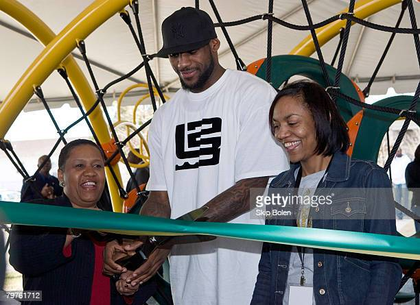 Pam El VP of Marketing at State Farm LeBron James of the Cleveland Cavaliers and his mother Gloria James attend a playground dedication by State Farm...