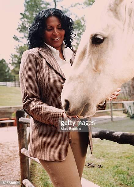 Pam Grier Feeding a Horse