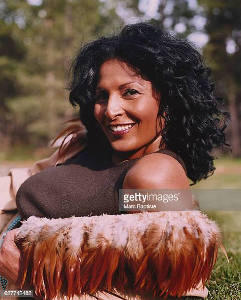 Pam Grier Reclining on Grass