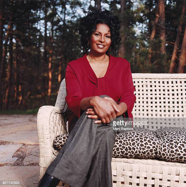 Pam Grier Seated Outdoors on Sofa
