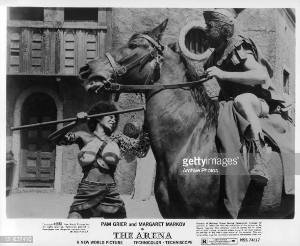 Pam Grier with pole stabbing warrior on horse in a scene from the film 'The Arena', 1974.