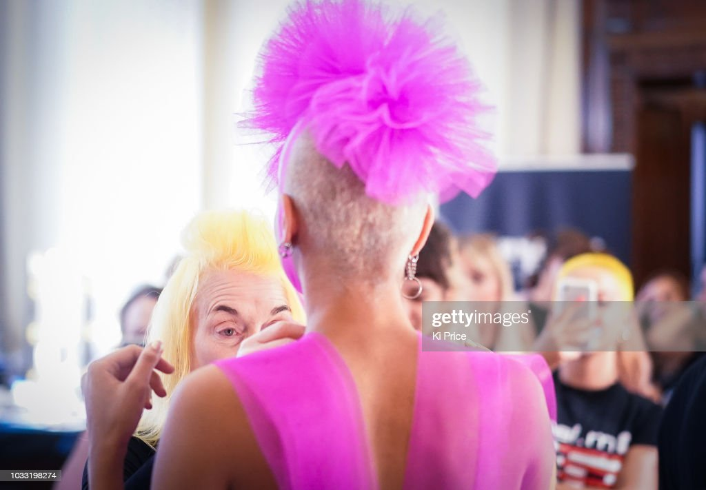Pam Hogg adjusts a model backstage ahead of the Pam Hogg Show during London Fashion Week September 2018 at Freemasons Hall on September 14, 2018 in London, England.