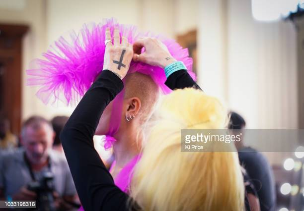 Pam Hogg adjusts a model backstage ahead of the Pam Hogg Show during London Fashion Week September 2018 at Freemasons Hall on September 14 2018 in...