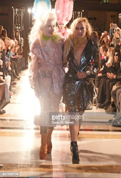 Pam Hogg and Alice Dellal walk the runway at the Pam Hogg SS18 catwalk show at Freemasons Hall during London Fashion Week on September 15 2017 in...